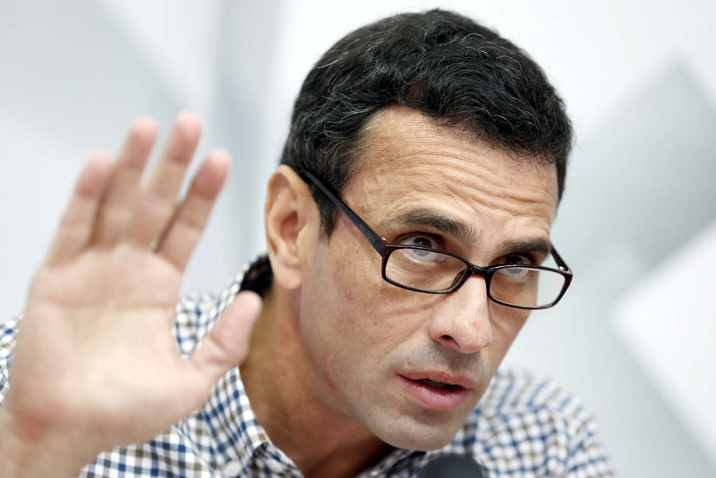 Venezuelan opposition leader Henrique Capriles talks to the media during a news conference in Caracas